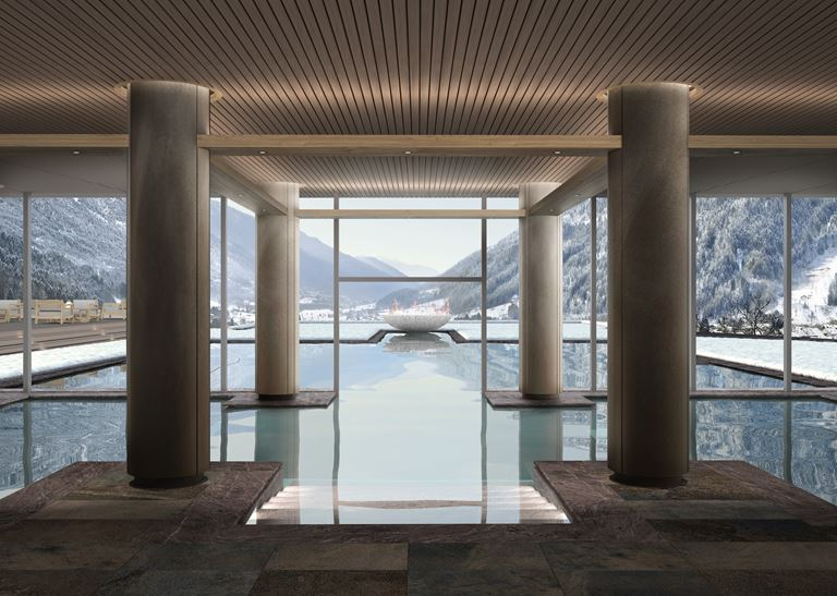Lefay Wellness Residences от Lefay Resorts в Доломитах, Италия - открытый бассейн с видом на Альпы